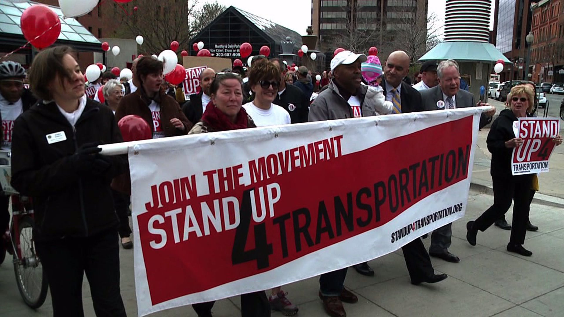 Stand Up for Transportation march in downtown Denver
