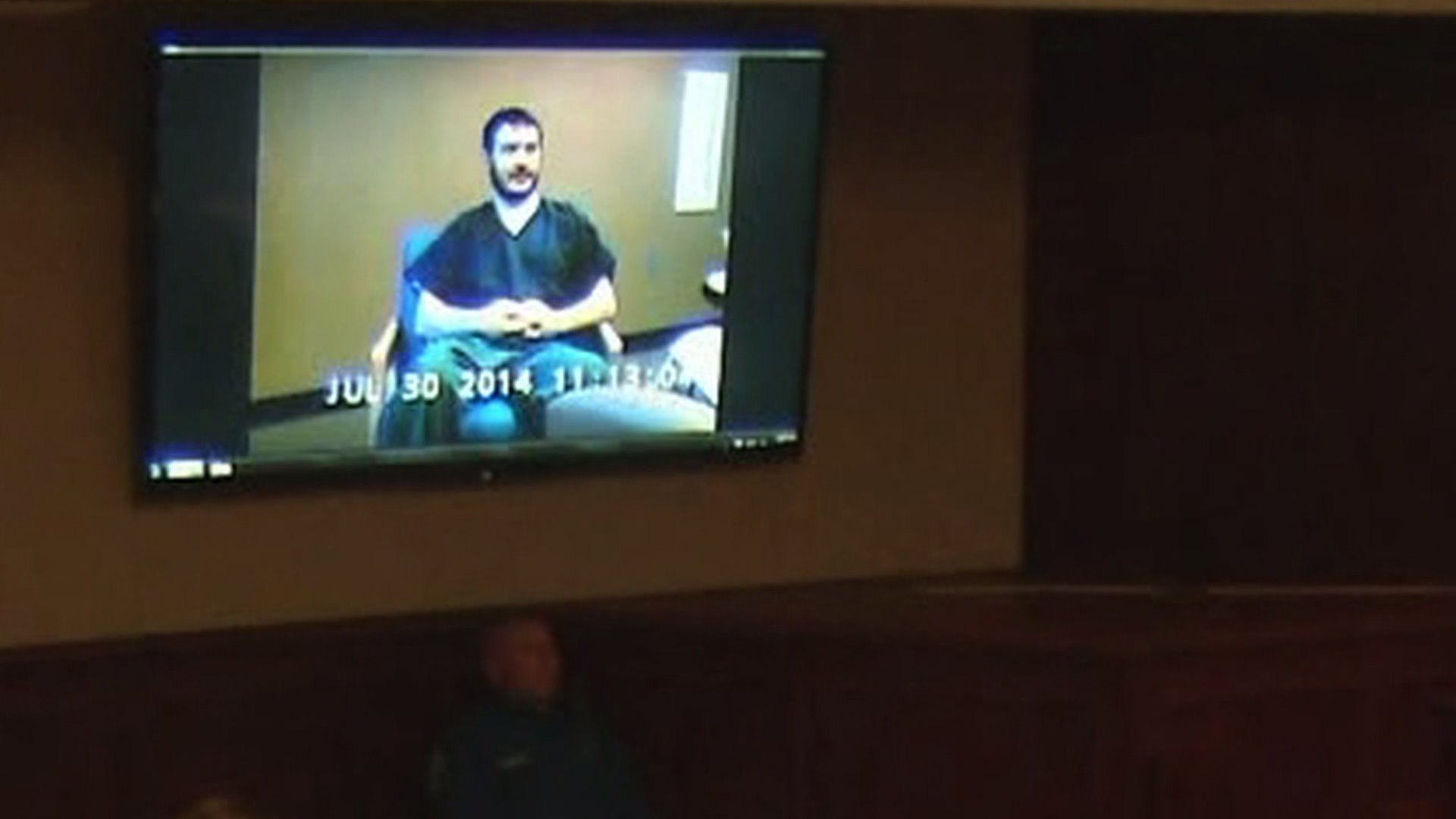 Jury watches video of Holmes mental evaluation