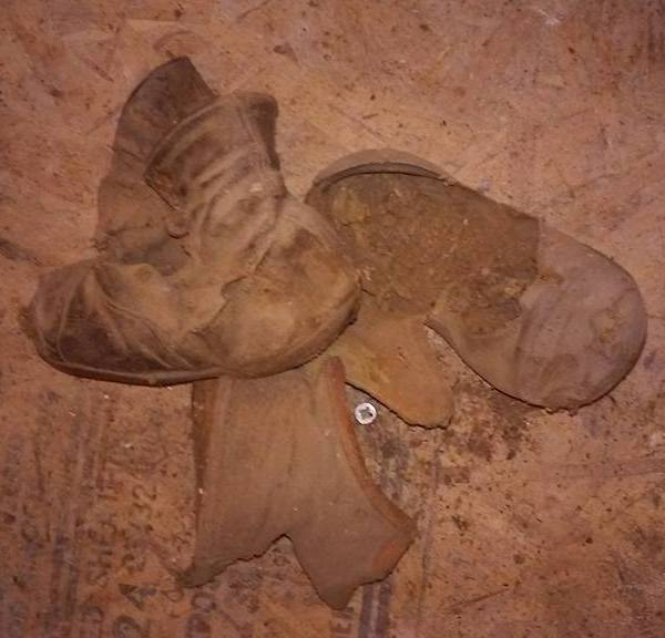 Toddler's shoes found buried inside Denver home