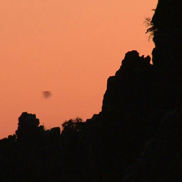Sunset over the Orient Mine where the black specs in the sky are bats flying over the horizon. (Photo: Anne Herbst)