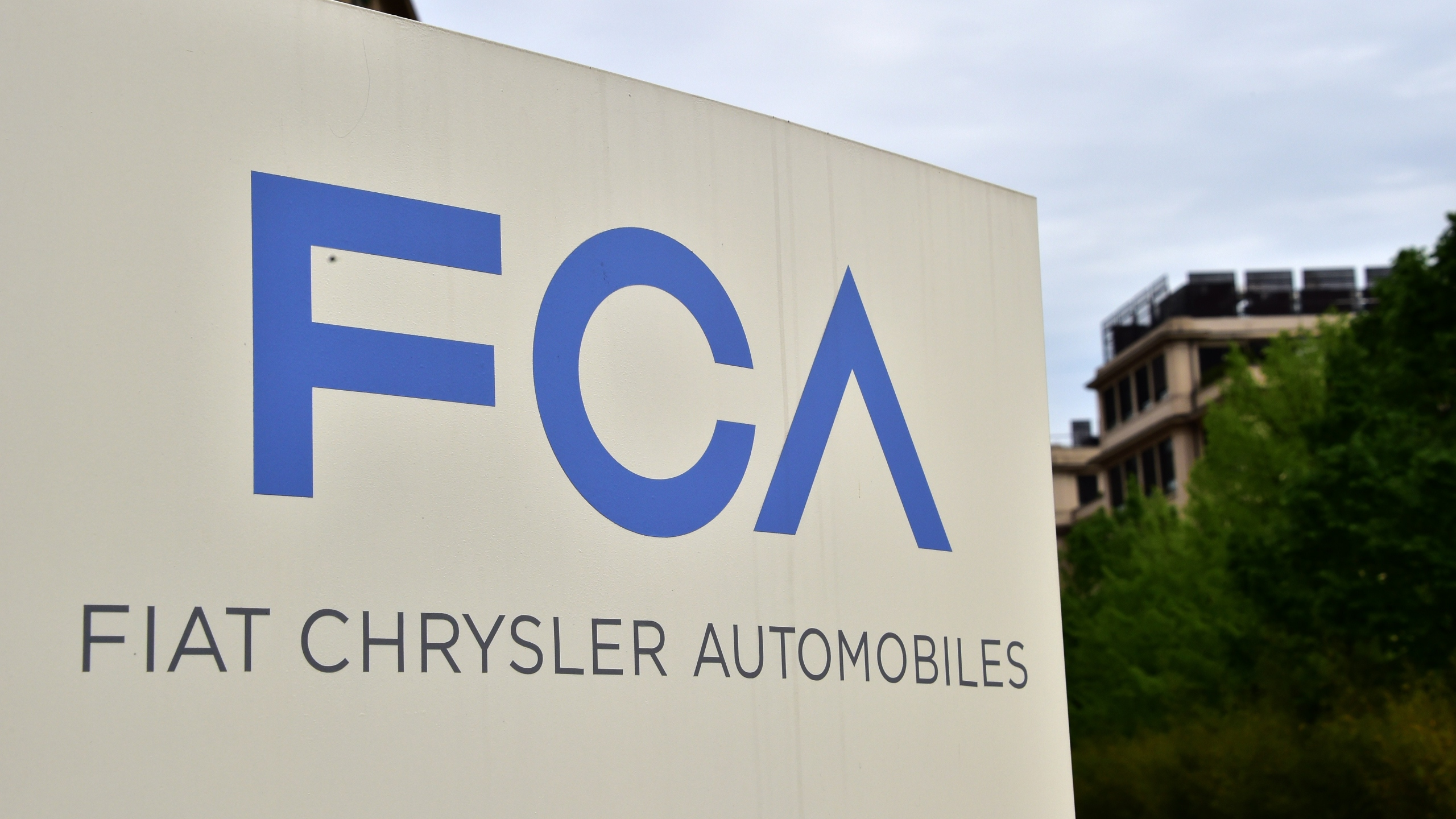 A picture shows the Fiat Chrysler Automobiles (FCA) logo at the entrance of the headquarters, on April 19, 2015 in Turin. (Photo: GIUSEPPE CACACE/AFP/Getty Images)