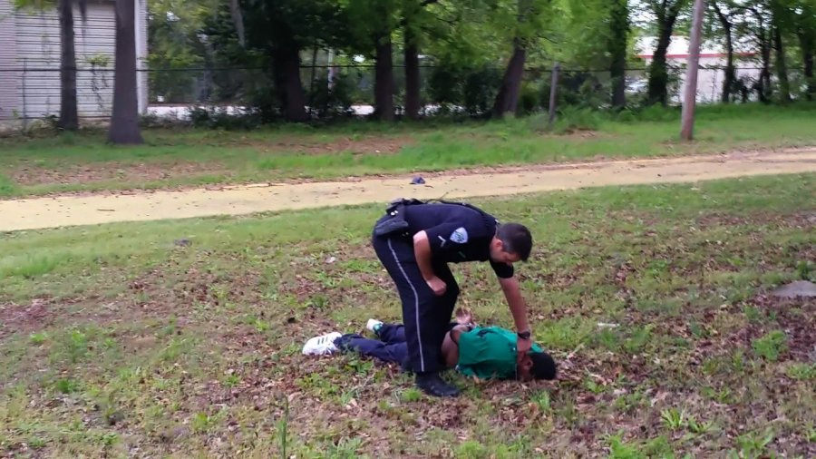 This still, released by the family of Walter Scott, appears to show North Charleston, South Carolina police officer Michael Slager shooting Scott in the back as he ran away from the officer. The incident took place Saturday, April 4, 2015. (Photo: CNN)
