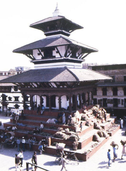 Kathmandu's losses included the completely demolished Narayan Temple pagoda, which was next to the devastated Shiva pagoda: both dominated Kathmandu's main Durbar Square. The Narayan temple, seen here in December 1995, was popular among traders who displayed food and household goods. Behind it, to the left, is the whitewashed entrance of the Virgin Goddess's dwelling place. (Photo: CNN)