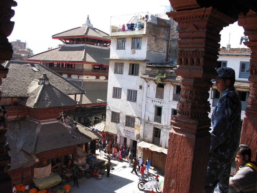 The lofty view in February 2008 from atop the Shiva temple pagoda's nine-step plinth, under its decorative triple-layered roofs which were completely destroyed along with the small structure below which was used as a shop. (Photo: CNN)