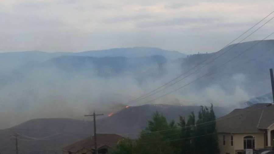 A wildfire burned out of control late Sunday, June 28, 2015, in central Washington, forcing residents in hundreds of homes to evacuate, authorities said. At least a dozen homes have been destroyed, said Rich Magnussen with the Chelan County Sheriff's Office. (Photo: CNN)