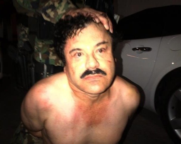 """El Chapo under arrest in 2014. A manhunt has been launched to find Mexican drug kingpin Joaquin Guzman after he escaped from prison, Mexico's National Security Commission said in a statement Saturday. Guards at the Altiplano Federal Prison found that Guzman, also known as """"El Chapo,"""" was missing during routine check. (Photo: CNN)"""