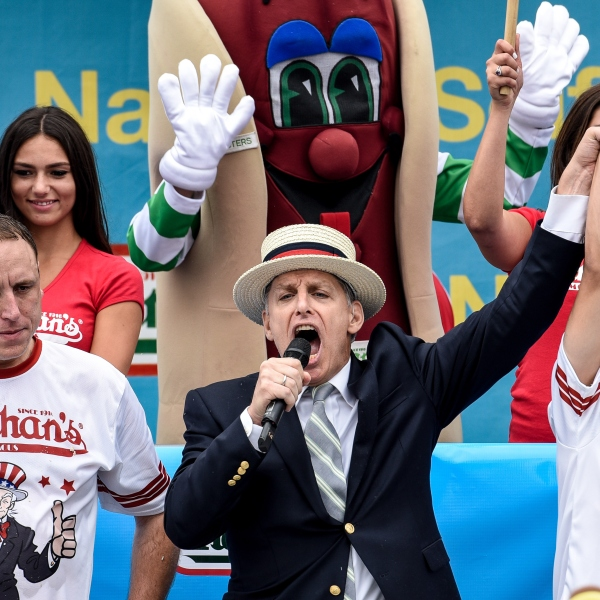 Mike Stonie defeats Joey Chestnut after eating 62 hot dogs at The Nathan's Famous Fourth of July International Hot Dog-Eating Contest in Coney Island, New York, on July 4, 2015. (Photo: Andrew Renneisen/Getty Images)