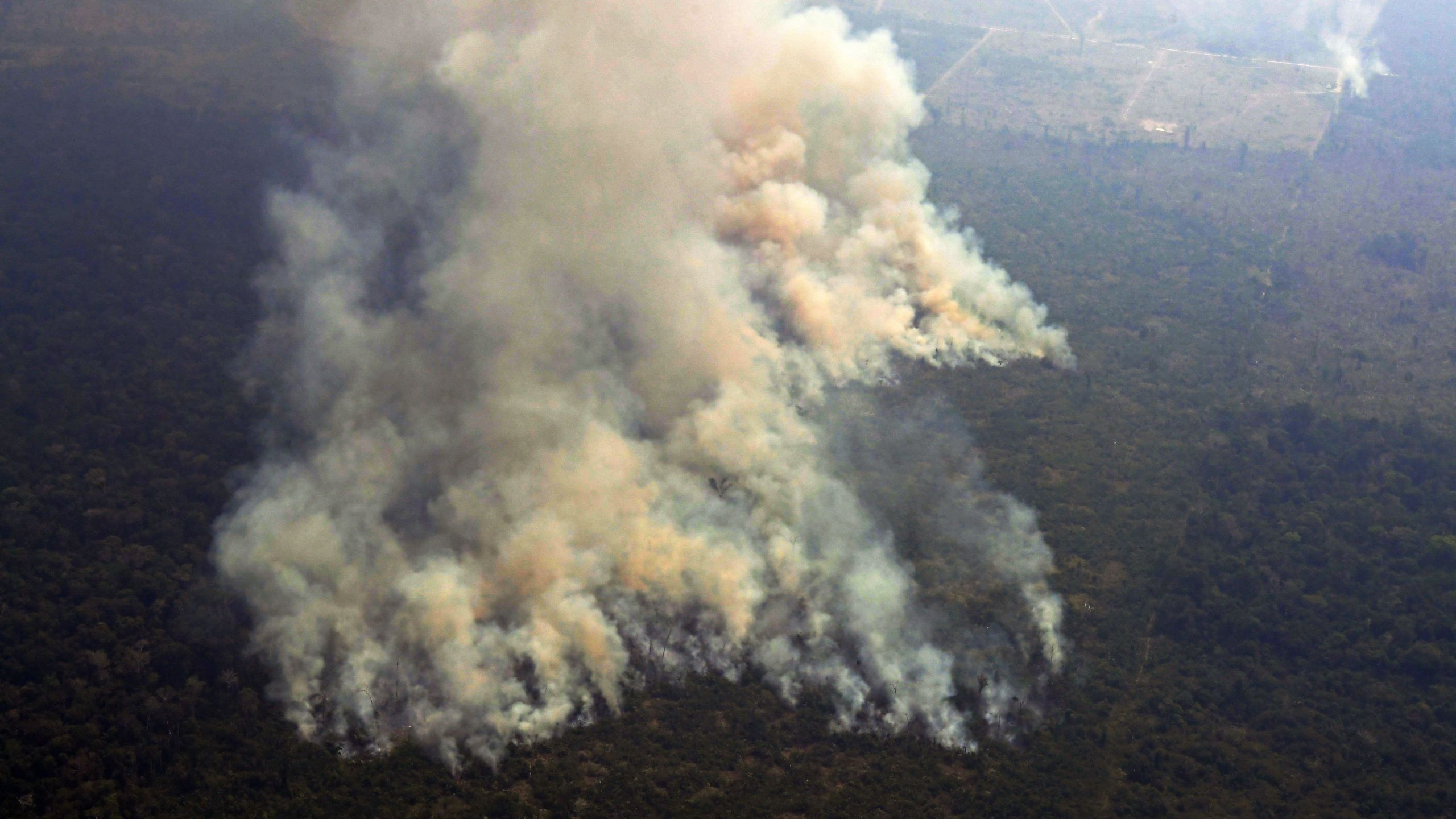 Aerial picture showing smoke from a two-kilometre-long stretch of fire billowing from the Amazon rainforest about 65 km from Porto Velho, in the state of Rondonia, in northern Brazil, on August 23, 2019. - Bolsonaro said Friday he is considering deploying the army to help combat fires raging in the Amazon rainforest, after news about the fires have sparked protests around the world. The latest official figures show 76,720 forest fires were recorded in Brazil so far this year -- the highest number for any year since 2013. More than half are in the Amazon. (Photo: CARL DE SOUZA/AFP/Getty Images)