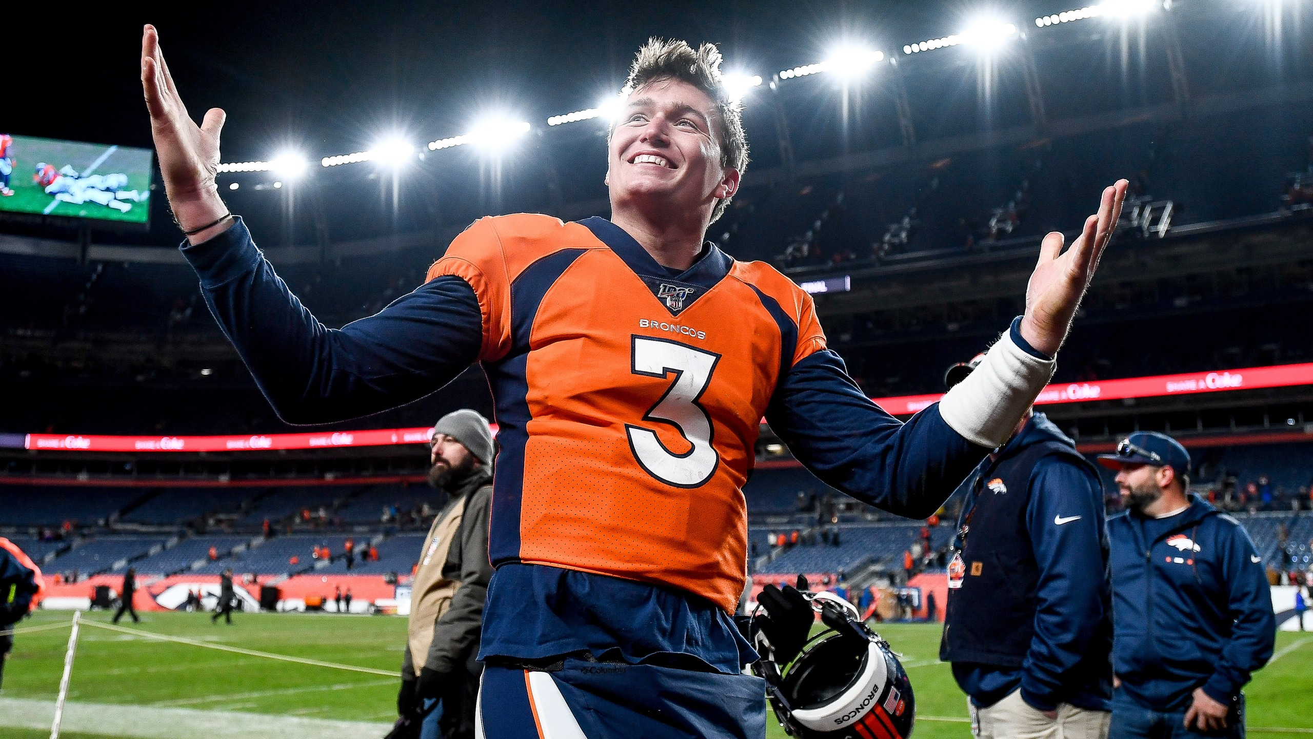 Drew Lock walks off the field after a 16-15 win over the Oakland Raiders at Empower Field at Mile High on Dec. 29, 2019.