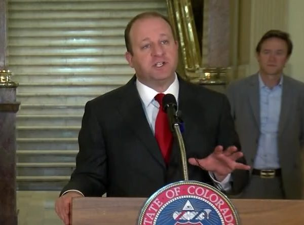Colorado Gov. Jared Polis holds a news conference on the state's response to COVID-19 on May 18, 2020.