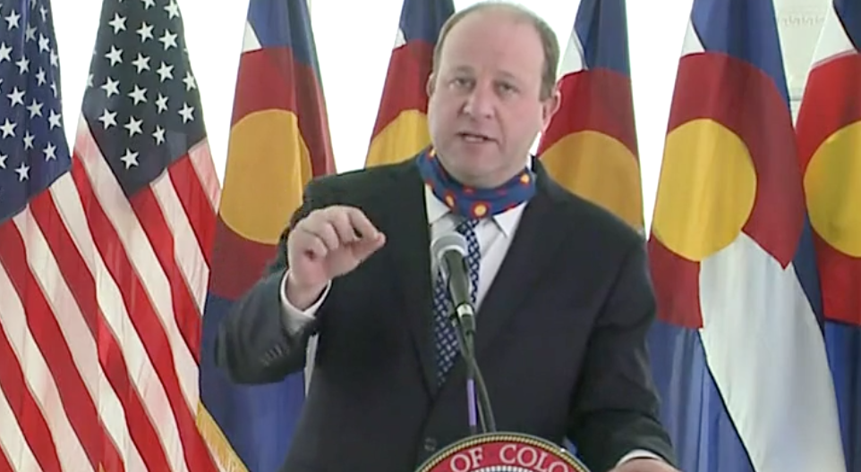 Gov. Jared Polis talks about what it'll take to reopen the state during a new conference on April 15.