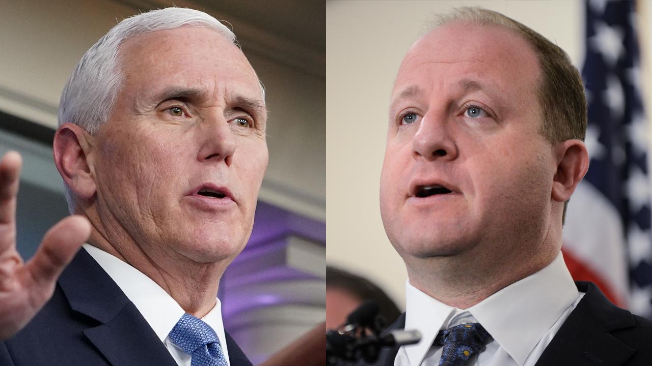 Vice President Mike Pence and Colorado Gov. Jared Polis