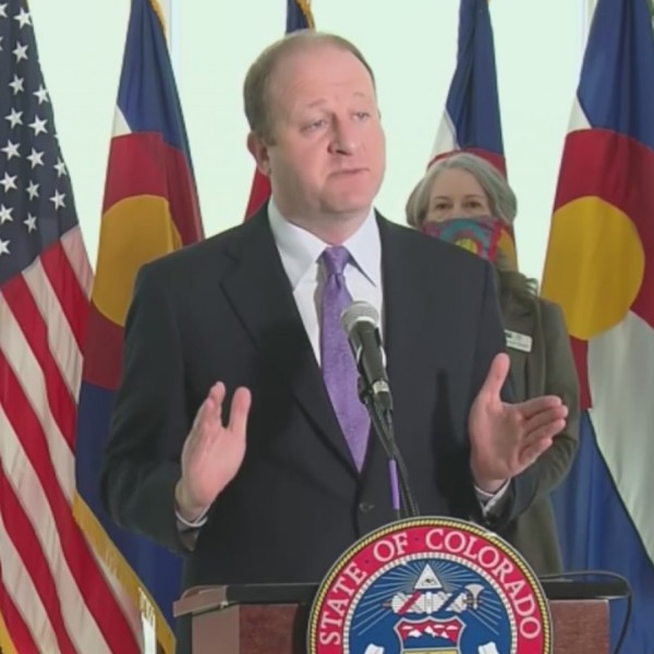 Gov. Jared Polis holds a news conference on COVID-19 in Colorado, on April 13, 2020.