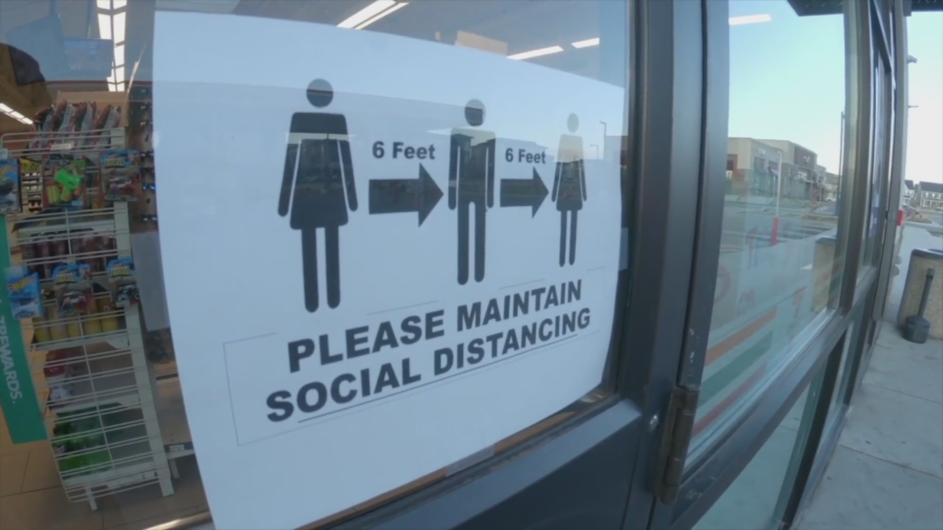 A sign reminds customers to social distance.