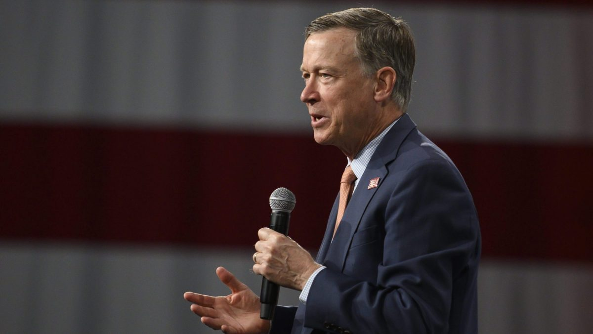 Former Colorado Gov. John Hickenlooper speaks on stage during a forum on gun safety at the Iowa Events Center on August 10, 2019 in Des Moines, Iowa.