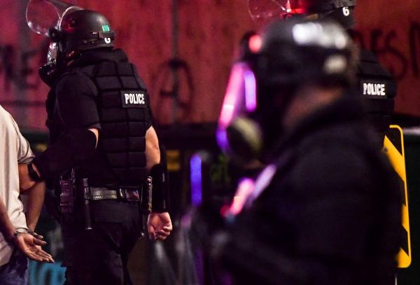 Police officers arrest a man during the fourth consecutive day of protests on May 31, 2020 in Denver.