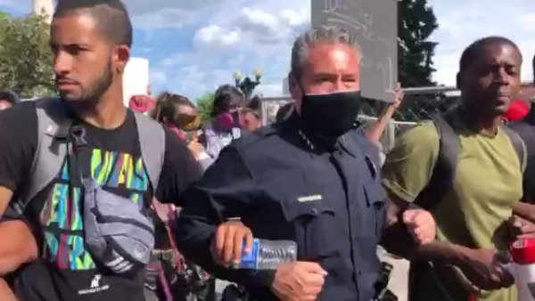 Denver police Chief Paul Pazen walked arm-in-arm with protesters Monday afternoon, June 1, 2020.
