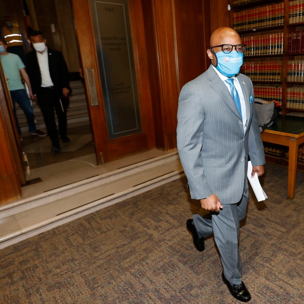 Denver Mayor Michael Hancock wears a face mask as he heads into a news conference on Tuesday, May 5, 2020, in Denver.