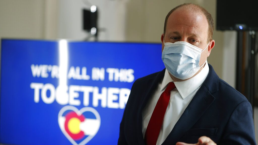 Colorado Gov. Jared Polis at a news conference coronavirus Thursday, July 9, 2020, in Denver.