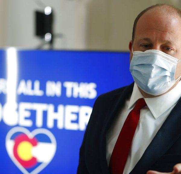 Colorado Gov. Jared Polis at a news conference coronavirus Thursday, July 9, 2020, in Denver.