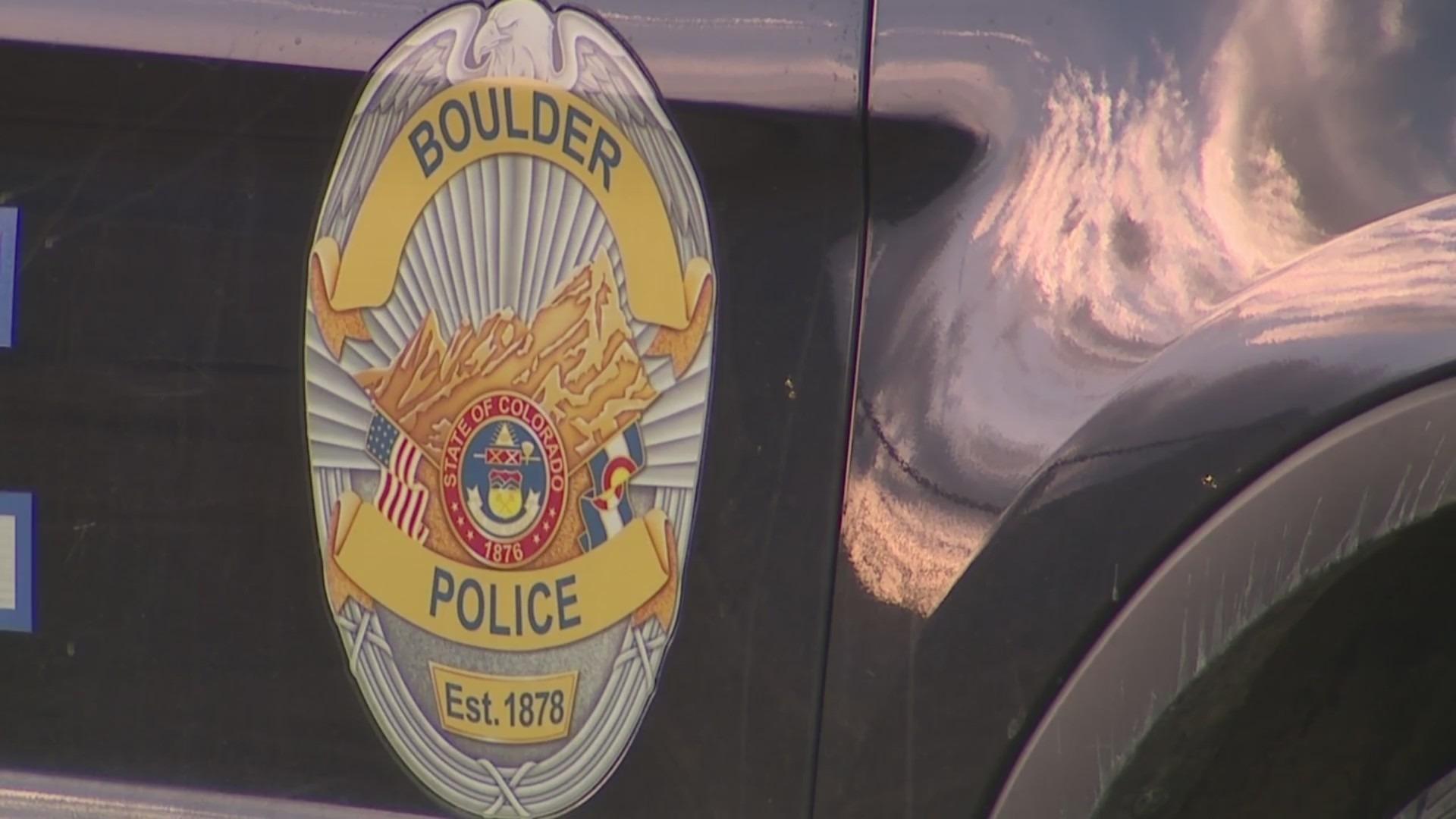 The side of a Boulder Police Department vehicle. Credit: KDVR