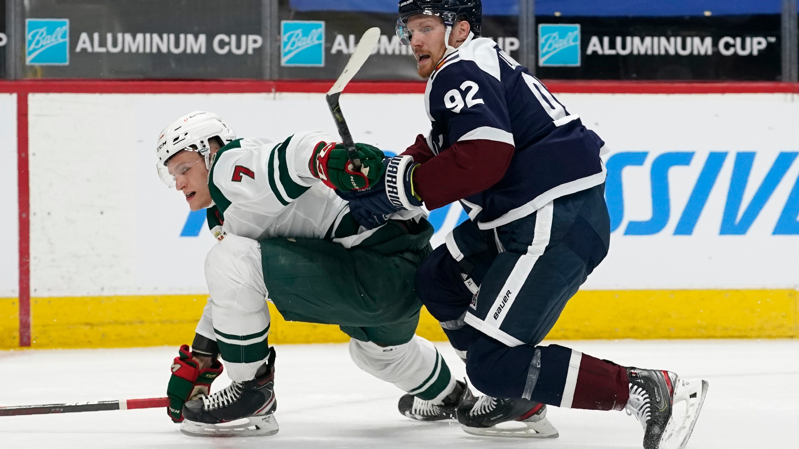 Minnesota Wild center Nico Sturm, left, is hit by Colorado Avalanche left wing Gabriel Landeskog in the second period of an NHL hockey game Thursday, March 18, 2021, in Denver. (AP Photo/David Zalubowski)