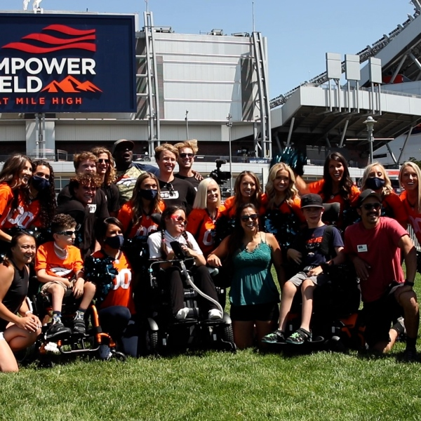 Broncos cheerleaders participate in camp for children with special needs