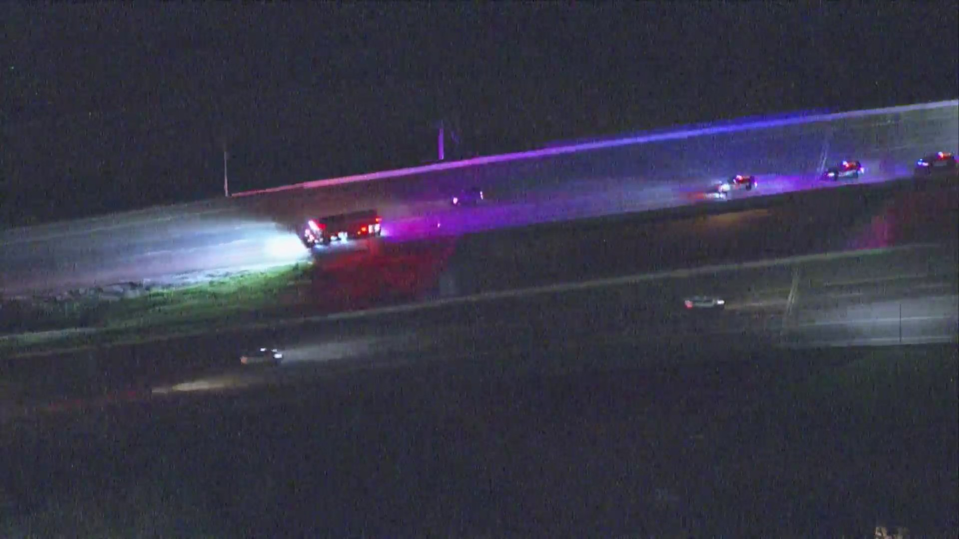 Aerial view at night of emergency vehicles on Interstate
