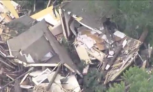 A house destroyed in pieces and bits from aerial view