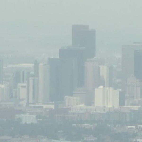 Downtown Denver skyline aerial view with haze fogging the view