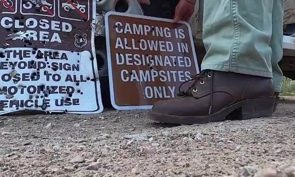 Campsite signage destroyed by bullet holes