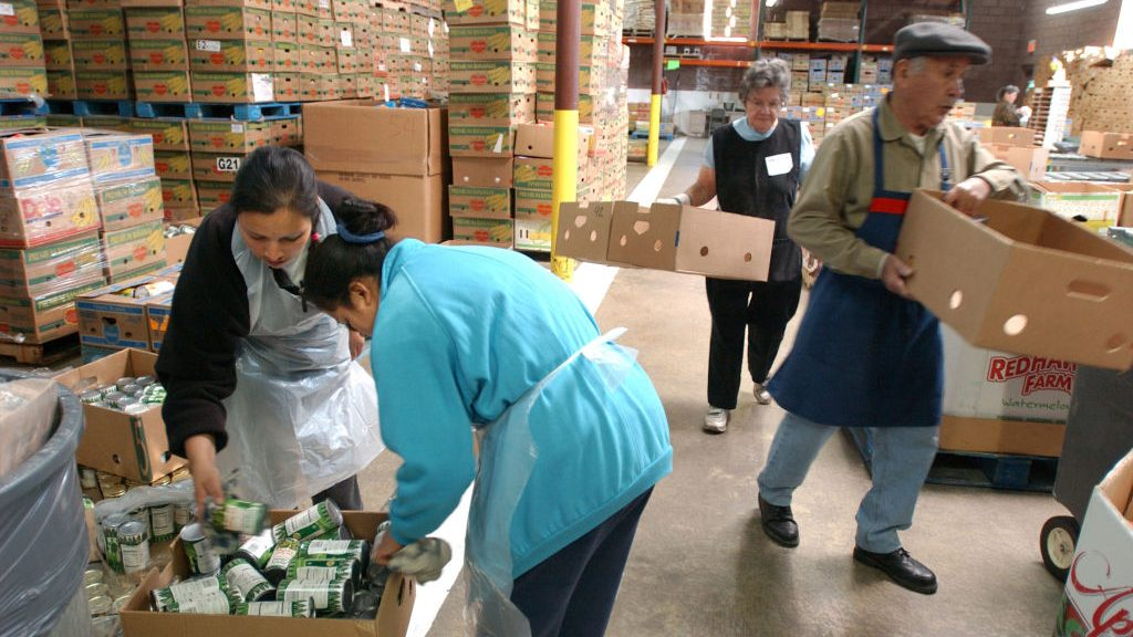 Volunteers in Denver sort donated food and move boxes at the Food Bank of the Rockies in this 2003 photo.